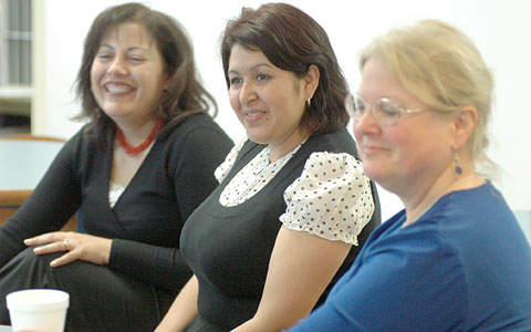 Maria Flores, community school coordinator; parent Patricia Bautista; and Port Chester Teachers Assocation President Linda O'Connor discuss the school's strategies for improvement. Photo by Maria R. Bastone.