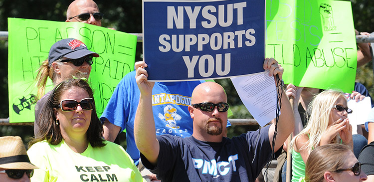 'nysut supports you' sign at rally