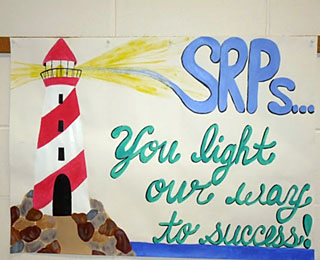 "SRP Recognition - ""SRPs. . .you light our way to success"" sign"