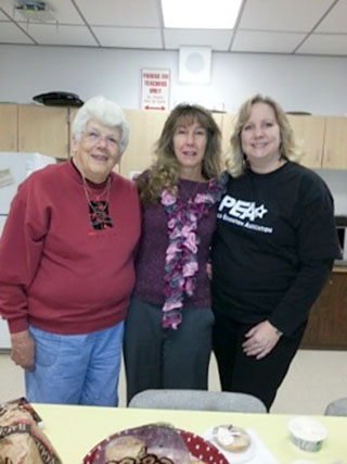 Penfield teaching assistant Nancy Sanders, secretary Mary Zweifel, and teacher Sue Mietus at Bay Trail Middle School for SRP Recognition Day.