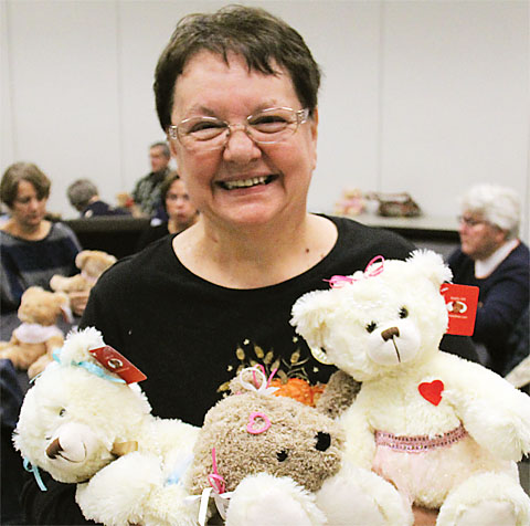 Retiree Ann Cherney holds some of the dozens of Joy Bears made by RC 10 members to help comfort cancer patients. Photo by Andrew Watson.