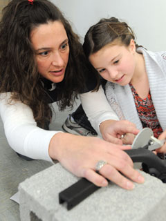 Galway teacher Carrie Herron shows student Maya Vanderhorst how to use the statapult during the Galway TA's after-school STEM Enrichment Initiative. Photo by El-Wise Noisette.
