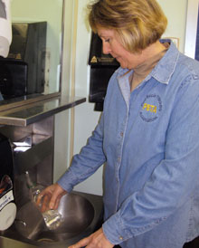 Judy Muller, Pine Bush TA vice president and head of the union's health and safety committee, takes samples of tapwater for testing.