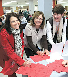 From left, Roberta Bittel, Student Government advisor; Canandaigua TA President Cheryl Birx; and special education teacher Barb Morgan sign valentines for lawmakers.