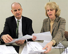 NYSUT officers Lee Cutler and Kathleen Donahue review applications for assistance through NYSUT's Disaster Relief Fund.