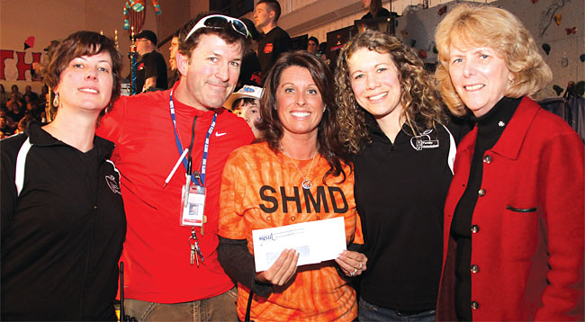 NYSUT Vice President Kathleen Donahue, right, joins members of the South Glens Falls Faculty Association, from left, Shannon Fagle-Fedele, Tom Myott, Jody Sheldon and Sarah Young in presenting a donation to the 37th annual South High Marathon Dance fundraiser in South Glens Falls.