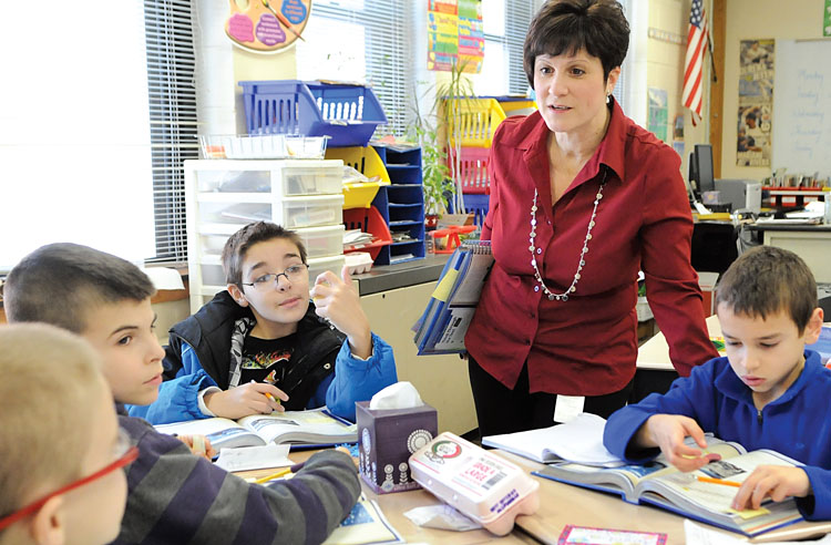 Levittown teacher Donna DiPalo, shown with her fourth-grade students, found the writing activities in the commercial Common Core program inadequate. Photo by Jonathan Fickies.