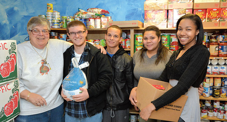 From left, Mary Ann Borrello, a Faculty Association of Suffolk Community College member, helps stock the union's food pantry along with student volunteers Christopher Somma, Islam Eltahlawy, Diamond Bates and Emaje Green. The FASCC donates to food pantries on all three SCC campuses to help students in need. Photo by Kevin Peterman.