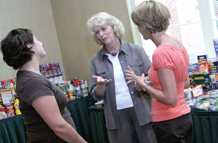 NYSUT Vice President Kathleen Donahue, center, chats with Jaime Williams, left, and Kari Cushing from the Franklin Community Center food pantry in Saratoga Springs. Locals participating in NYSUT's Local Action Project annually donate hundreds of pounds of food to the center. Photo by Andrew Watson.