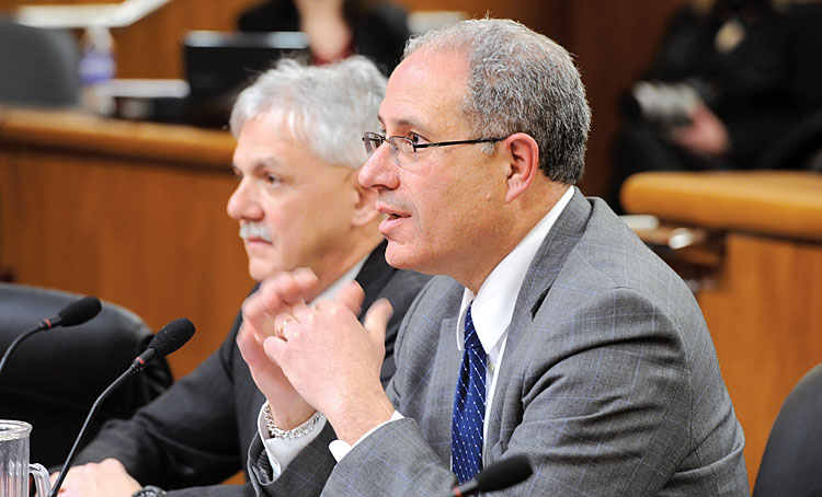 NYSUT Executive Vice President Andy Pallotta, right, with Director of Legislation Steve Allinger, tells the joint legislative hearing that the state must more than double the governor's proposed aid to education to $1.9 billion.