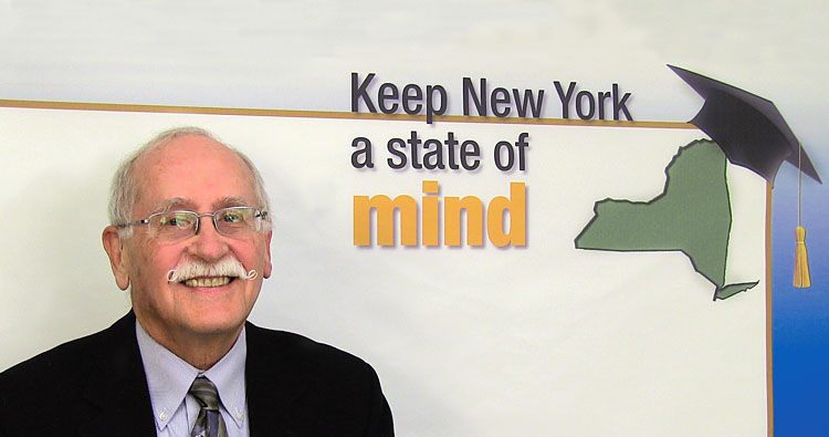 "Tom Mathews, a UUP member from SUNY Geneseo and NYSUT Board member, videotapes a messages about the value of public higher education as part of NYSUT's new ""Keep New York a state of mind"" campaign. Photo by Andrew Watson."