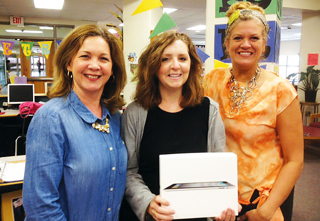 From left, Baldwinsville TA Vice President Julia Yando and President Beth Chetney congratulate member Kim Charest, center, on winning the local's most recent disaster relief raffle. The BTA raised nearly $1,500 by raffling off a new iPad, with all proceeds going to the NYSUT Disaster Relief Fund. The BTA, a 2010 graduate of the NYSUT Local Action Project, conducts annual fundraisers to support the NYSUT fund.