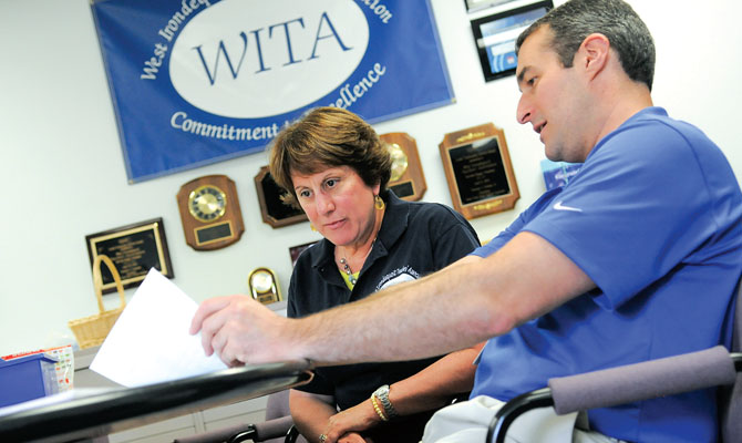 "West Irondequoit TA President Scott Steinberg speaks with WITA member Patty O'Connor about plans to call voters to remind them to vote ""YES"" on the budget revote in June. Photo by Steve Jacobs."