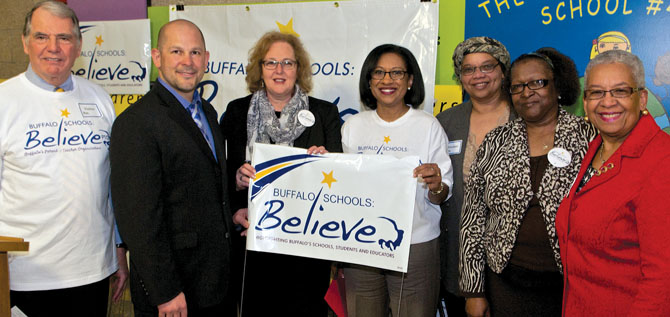 Buffalo TF President Phil Rumore; Larry Scott, co-chair of the new Buffalo Parent-Teacher Organization; NYSUT President Karen E. Magee; Pamela Brown, superintendent of Buffalo schools; Roberta Cates, BPTO co-chair; BEST President JoAnn Sweat; and Barbara Seals Nevergold, Buffalo school board president, at the media event. Photo by Dennis Stierer.