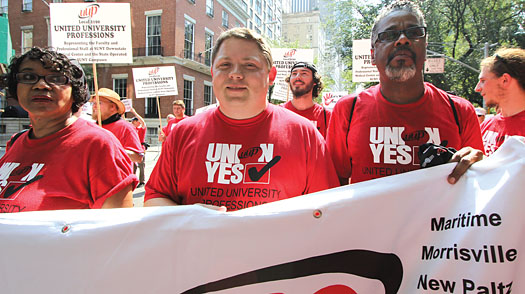 Downstate Medical Chapter President and UUP Treasurer Rowena Blackman-Stroud, NYSUT Secretary-Treasurer Martin Messner and UUP Vice President for Professionals J. Phillipe Abraham march in the annual Labor Day parade in Manhattan.