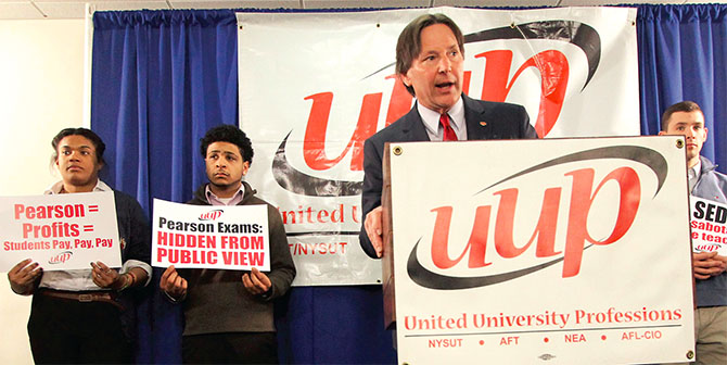 UUP President Fred Kowal, flanked by SUNY students, calls for an investigation into SED's newly implemented, and problematic, teacher certification exams. Photo by Mike Lisi.