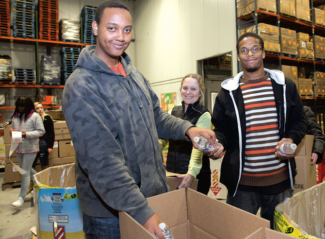 Bridge students and Berkshire TA Vice President Helen Thompson, center, help out at the Regional Food Bank of Northeastern New York.