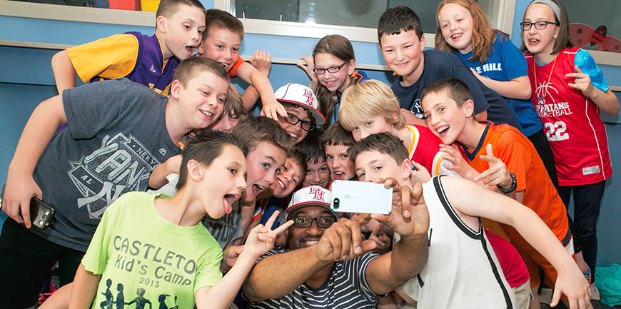 2015 Newbery Medal winner Kwame Alexander  takes selfies with fifth-graders at Castleton Elementary School. Photo by Marty  Kerins Jr.