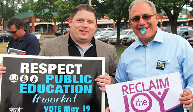 NYSUT officers Martin Messner, left, and Andy Pallotta help get out the vote for school budgets. Photo by Nicholas Dicocco.