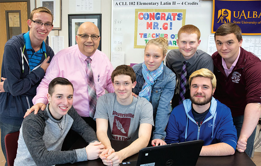 Some of Mr. G's students work on language presentations during study hall. Front row, from left: Justin Putnam, Sedrik Nellis and Riley Palmer. Back row: Tyler Unislawski, teacher Charlie Giglio, Emily Ross, Bradley Mulligan and Joshua Young. Photo by Marty Kerins Jr.