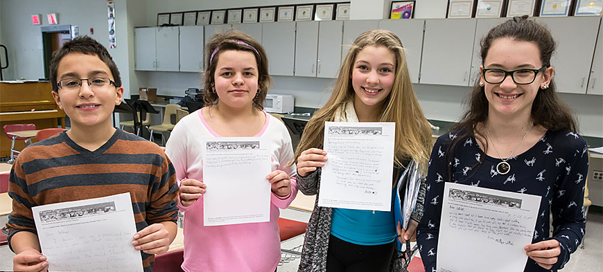 From left: Minisink students Michael, Adrianna, Jenna and Hannah hold the letters they wrote to soldiers.