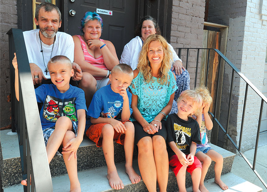 Troy teacher Noelle Frederick, front center, and teaching assistant Marilyn Barton, back right, make a home visit with Joseph and Stephanie Williams and their four children. Educators at Troy School 2 met with more than 100 families before school began.