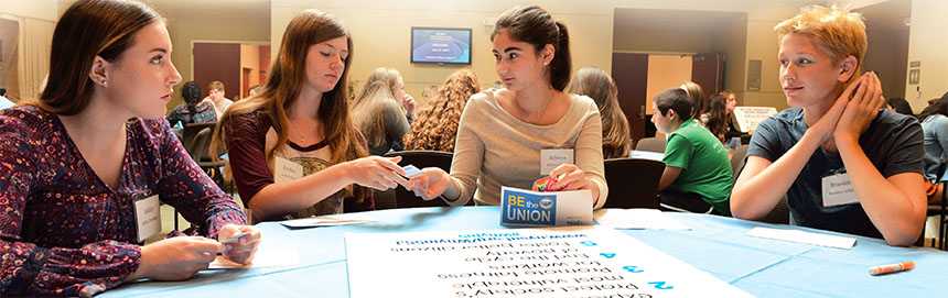 From left, students Ashley Davidson, Jordan Scull, Rebecca Hyatt and Braeden Arthur use NYSUT's Why in 5 cards to start a conversation about various social justice topics. Photo by El-Wise Noisette.