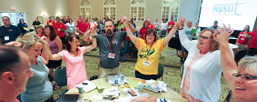 Members of the Copenhagen Teachers Association,a first-year LAP local, join NYSUT President Karen E.Magee, right, in a team-building moment during thesummer session of NYSUT's Local Action Project. Photo by El-Wise Noisette.