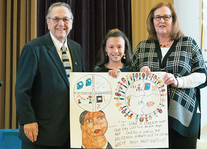 NYSUT Executive Vice President Emeritus Alan B. Lubin and NYSUT President Karen E. Magee congratulate Janessa Jones, a Schenectady sixth-grader, for her first-place award in the Alan B. Lubin MLK Poster Contest. Evelyn Meddaugh, also a Schenectady sixth-grader, won second place.