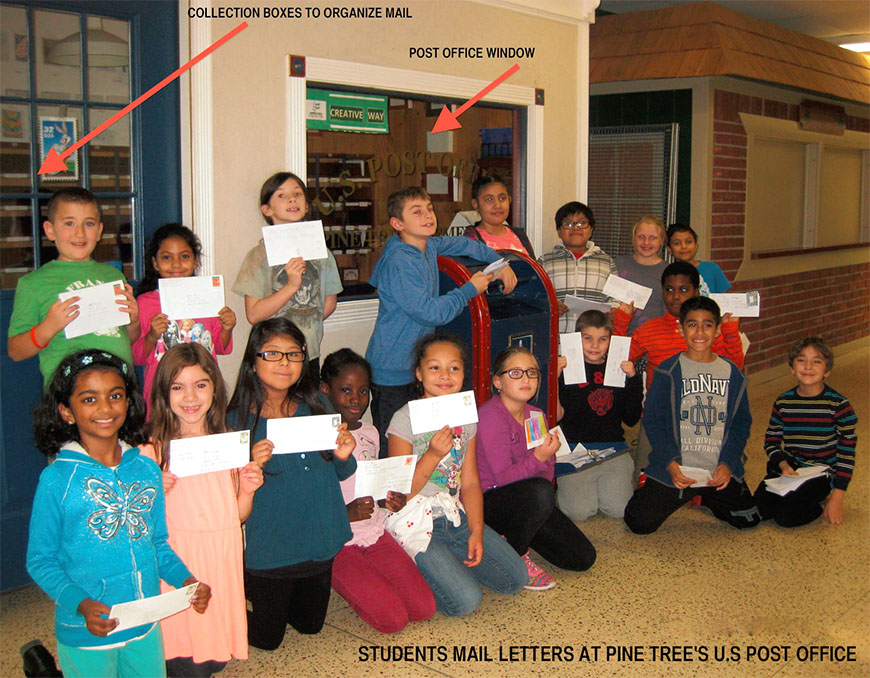 "Students at Pine Tree Elementary School in Monroe display thank you letters they mailed to SRPs at the school's ""post office."" SRPs received more than 800 letters from students."