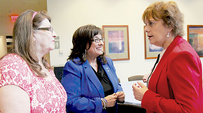 From left, Colleen Condolora, Capital Region BOCES TA, and Sandie Carner-Shafran, Saratoga Adirondack BOCES EA, discuss concerns with NYSUT Vice President Catalina Fortino.