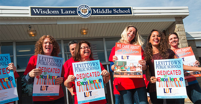 On Long Island, members of the Levittown United Teachers rallied for public education at Wisdom Lane Middle School.
