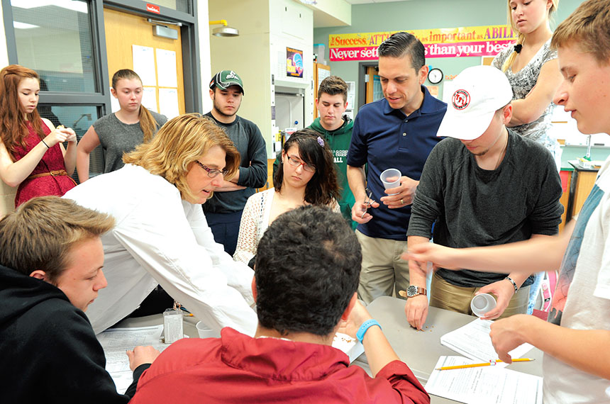 Assemblyman Angelo Santabarbara (standing, center) and Schalmont High School students get ready to work together on a biology project with Schalmont TA science teacher Michele Freeman. Photo by El-Wise Noisette.