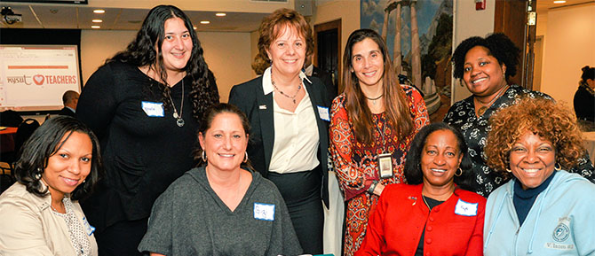 NYSUT Vice President Catalina Fortino and teachers from the Roosevelt Union Free School District celebrate newly designated National Board Certified Teachers at a NYSUT-sponsored event at Adelphi University.