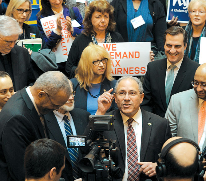 "NYSUT's Andy Pallotta, above, tells hundreds of coalition activists about his ""bucket list"" at a rally on the Capitol's Million Dollar Staircase."