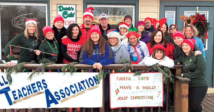 Members of the Monticello Teachers Association, with NYSUT Secretary-Treasurer Martin Messner, third from left, prepare for the union's second annual Tinsel Trot 5K. The event drew more than 200 participants — and raised more than $12,500 to benefit the MTA Scholarship Fund and the Sullivan County Federation for the Homeless. MTA President John Maranzana said the event owes its success to many members, including Sheryl Manz, Tim and Allie Billias and Gary Silverman.