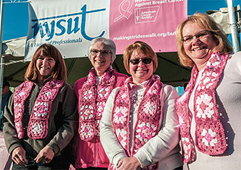 From left: Kathy Scalfani, Bonnie Krupper, Jackie Leggett and Donna Parent, all members of the Lewiston-Porter Administrative Professionals, model scarves made by Leggett.The women participated in the Buffalo Making Strides Against Breast Cancer walk in October. For more photos of walks around the state, visit www.nysut.org.