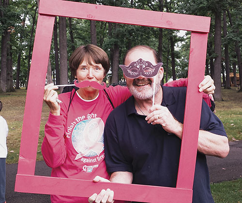 RC 11 retirees Linda and Ben Frisbie of the Owego-Apalachin Teachers' Association stop by the NYSUT photo booth at the Binghamton Making Strides Against Breast Cancer walk in October. The chapter raised $1,000 for the walk. Ben Frisbie is a former NYSUT Board member.