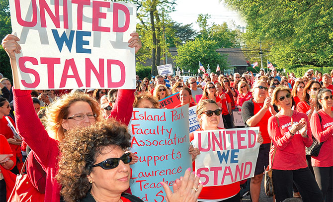Hundreds rally in Lawrence, Nassau County, to support Lawrence TA members who have been working without a contract for the last six years. The local represents about 300 teachers, librarians, speech therapists and social workers.