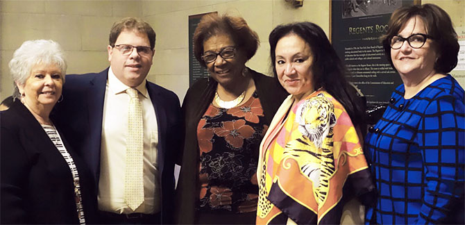 Yonkers teacher Mitchell Polay, second from left, celebrates his award with, from left, his mother, Anita Carangelo; Regent Judith Johnson; Chancellor Betty Rosa, and Commissioner MaryEllen Elia.