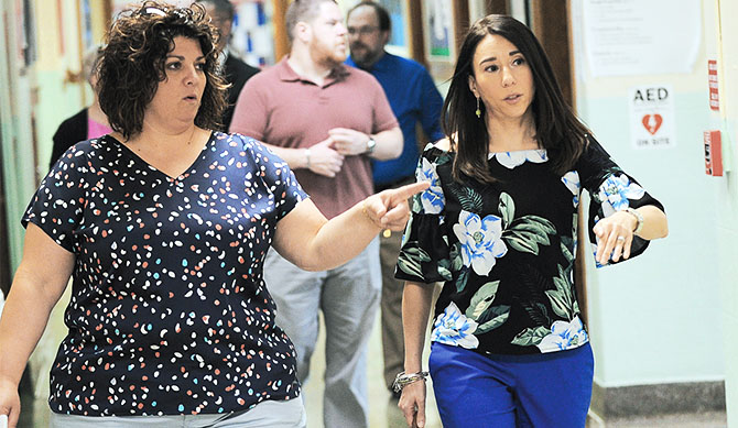 NYSUT Executive Vice President Jolene DiBrango, right, walks with Nicole Capello, vice president of Syracuse TA, during a recent visit with teachers and students at the Salem Hyde Elementary School. Photo by Steve Jacobs.