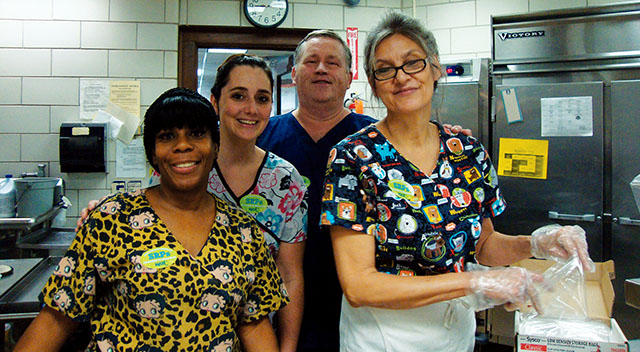 The professionalism of Syracuse TA members at the Webster school were on full display when they were asked to feed the entire student body in just under one hour. Above, from left, School-Related Professionals members Lynette Warren, Suzanne Pena, Larry Brennan and Marilyn Sutliffe served more than 600 lunches in record time when they learned the school was closing early due to a water main break. Kudos!