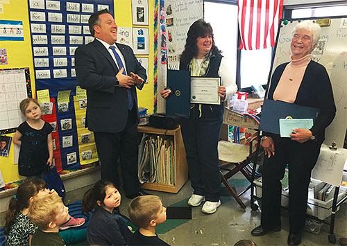 Albany County Executive Dan McCoy presents Judy Tambasco, center, retired teacher, and Roz Moser, retired school nurse; with Citizens of the Month certificates to honor their volunteer work. For 20 years, Tambasco and Moser have volunteered to run the 1,000 Book Child reading program for young students at Berne-Knox- Westerlo school district. The pair started the program to encourage youngsters to read, and each week participating students are given a bag of 10 books to take home.
