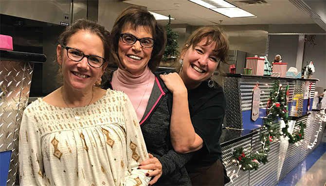 An army of volunteers keep the South End Children's Café running, including, from left, Bethlehem teacher Cindy MacCallum, volunteer Sandra Munella Olson and cafe founder, Tracie Killar.
