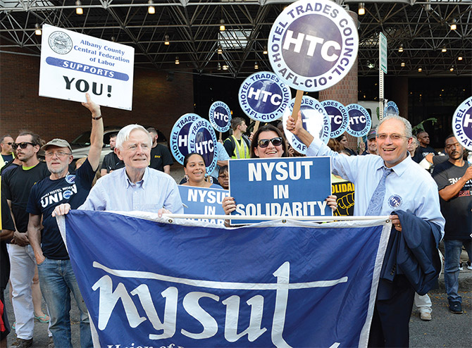 NYSUT Board member Anthony McCann, RC 10, joins NYSUT President Andy Pallotta and other activists in boycotting and picketing outside the Albany Hilton, whose new owners refuse to agree to a fair contract.