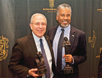 NYSUT President Andy Pallotta, left, and First Vice President/Secretary- Treasurer J. Philippe Abraham are honored by Alpha Phi Alpha during the NYS Association of Black and Puerto Rican Legislators caucus this winter. Photo by El-Wise Noisette.