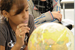 student with globe